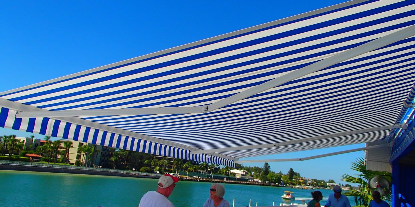 Shark Tales restaurant and KE Outdoor Elite retractable awning